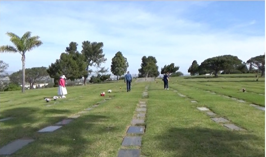 searching for famous graves in Holy Cross Cemetery