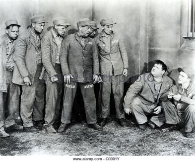 pardon-us-1931-hal-roachmgm-film-with-oliver-hardy-crouching-right-c0391y